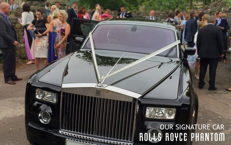 Rolls Royce Phantom dressed in white ribbons waiting until the photos afterwards are completed